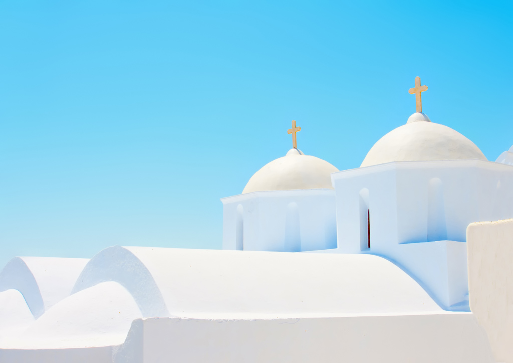 2 Beautiful old white twin churches in Chora the capital of Amorgos island in Greece