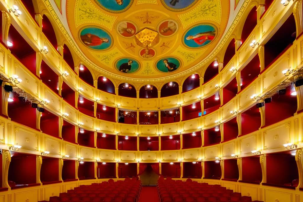 ERMOUPOLIS - JULY 2017: Interior of the famous Apollo Theatre by the Italian architect Pietro Campo in Syros Island. Its a miniature version of the La Scala in Milano